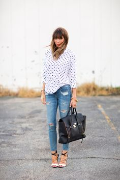 distressed denim and a polka dot blouse.