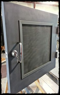 No door too small.... Custom hollow metal door manufacturered by House of Doors, louver with insect screen, stainless steel hinges and deadbolt for use in a customers crawl space — at House of Doors - Roanoke, VA