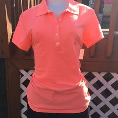 Polo shirt Orange polo shirt. Bust measures 18 inches and length from shoulder to bottom seam 23 inches Aeropostale Tops Tees - Short Sleeve