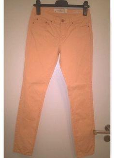 Světle oranžové plátěné kalhoty