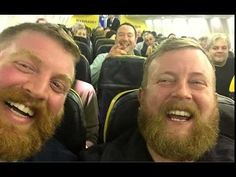 A man met his doppelganger on a recent flight -- and their selfie is now going viral. Neil Douglas boarded the Ryanair flight and found a stranger, Robert Stirling, of London, sitting in his seat f. Beards And Mustaches, Easy Listening, Nicolas Cage, Identical Twins, Wtf Fun Facts, Crazy Facts, Two Men, Stirling, Look Alike