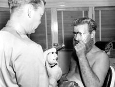 in the make-up chair, getting ready for his role as Akhoba, for One Million B. Lon Chaney Jr, One In A Million, People, Chair, Makeup, Black, Make Up, Black People, Stool
