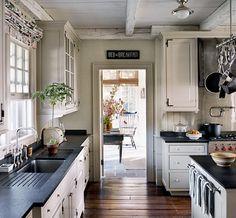cozy farmhouse kitchen [dark countertops + cream cabinets]
