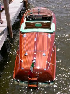 Wood Wooden Boat Restoration Antique Vintage boats for sale and restored Macatawa Bay Boat Works Saugatuck Michigan I know it doesn't have wheels but that's nice Riva Boot, Wooden Speed Boats, Chris Craft Boats, Boat Restoration, Wood Boat Plans, Bay Boats, Classic Wooden Boats, Classic Yachts, Vintage Boats