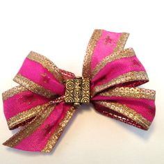 Hair accessory: Handcrafted hair clip with fuschia ribbon, gold trip and center embellishment by OmaDesigns on Etsy