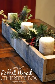 Fill this DIY wood pallet centerpiece with candles, greenery, and berries to make a tablescape even more festive.