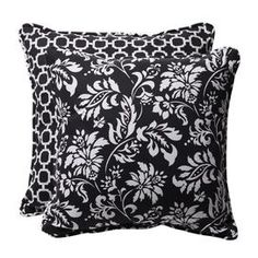Set of two indoor/outdoor throw pillows with floral motifs and reverse trellis detail.  Product: Set of 2 pillowsConstruction Material: Polyester cover and recycled virgin polyester fiber fillColor: Black and whiteFeatures:  Inserts includedReverses to trellis designSuitable for indoor and outdoor useWithstands UV rays, resists mold, mildew, stains, and moistureMade in the USA Dimensions: 18.5 x 18.5 eachCleaning and Care: Spot clean or hand wash fabric with mild detergent