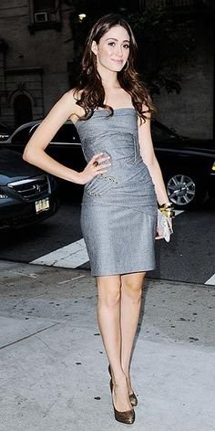 It`s been a fashionable Fashion Week for the front-row fixture, who heads to a magazine party in N.Y.C. in another winning look, pairing an elegant gray strapless dress with metallic pumps.