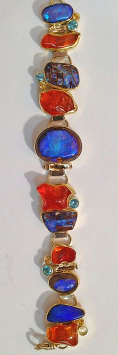 Boulder opal and Mexican opal bracelet in and gold. By Jennifer Kalled; Boulder opal from Bill Kasso Jewelry Art, Gemstone Jewelry, Jewelry Bracelets, Jewelry Accessories, Fine Jewelry, Jewelry Design, Jewellery, Bangles, Modern Jewelry