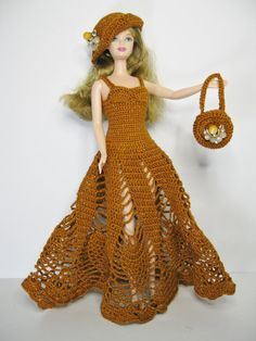 All inclusive gift which includes the doll plus beautiful russet metallic handmade crochet dress, hat, purse and brown shoes. The flowers on the