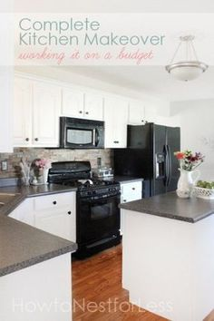 Complete kitchen makeover on a budget. Love the white cabinets ... and love seeing it with black appliances and the gray countertops