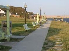 Southport NC, we used to go here when i was little. There was a ice cream truck that came there certain days of the week and we would get ice cream & sit on these benches & watch all the boats go by........