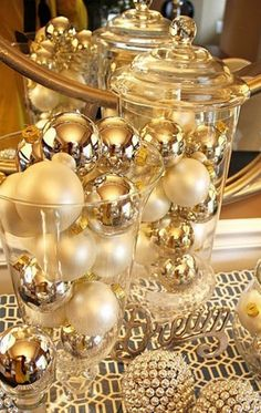 Fill apothecary jars and vases with ornaments for a pretty arrangement.