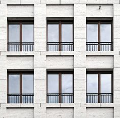 Facade of the Haus am Max Reinhardtplatz in Berlin by KLeihues + Kleihues Architekten. Photo taken from the Deutsches Architektur Forum, edited by NOMAA marco jongmans. Classic Architecture, Facade Architecture, Amazing Architecture, Chinese Architecture, Futuristic Architecture, Building Exterior, Building Facade, Building Design, Stone Facade