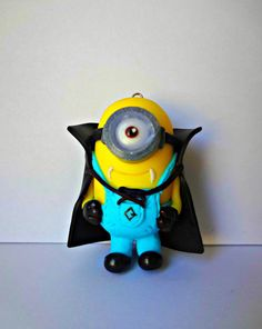 Dracula Minion Necklace / Pendant  Polymer Clay by MinionTreasures on Etsy: https://www.etsy.com/listing/218859606/dracula-minion-necklace-pendant-polymer?ref=shop_home_feat_3