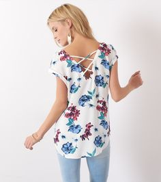 16041ec835 A flirty floral shirt with sexy cross back detail