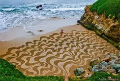 Amazing Oasis: A Man Takes A Single Rake to The Beach. And When You Zoom Out And See It…