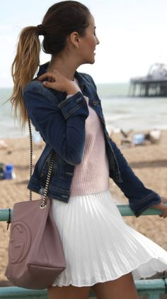 Tamara Kalinic is wearing a white skirt with pleats from TopShop, pink jumper from 360, denim jacket from Bershka and the bag is from Gucci