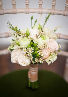 White bouquet with green foliage   http://onefabday.com/rustic-wedding-decor-table-ideas/