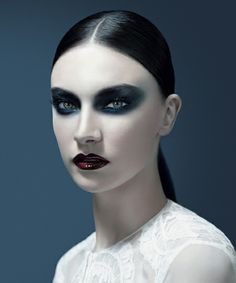 Queen of Hearts's makeup. The strong lips and eyes makeup is very powerful. On the queen it shows that she is in power of the land, not the king.