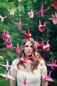Paper crane lovely-ness... maybe hanging from tree branch as centerpiece.