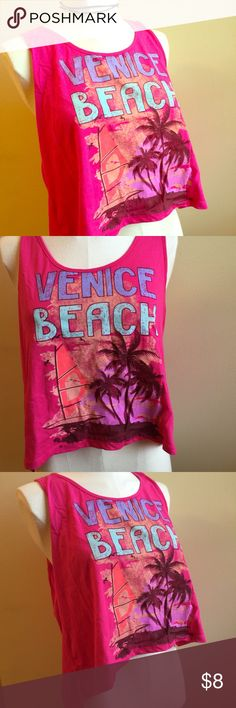 "High Low Venice Beach F21 Crop Top Surfer Neon XL Brand new, but missing tags, forever 21 high-low hem top. Top is shorter in the front and made of soft cotton. On the front of the shirt is a graphic saying ""Venice Beach"". Great for Summer. Size large, but can fit Xl also. Chest is 40"" but stretches. Waist is free size. Forever 21 Tops Crop Tops"