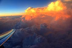 Howard L. Cohen Picture Page.  UFL Astronomy. TOWERING CUMULUS CLOUDS AT SUNSET 2010 May 2, 07:41 p.m. CDT Ft. Worth/Dallax, TX to Jacksonville, FL American Airlines Flight #574 From 30,000+ ft Over S. Cent. Miss., USA EPOD (2010-06-11)