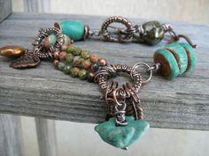 Charm bracelet ...antiqued copper ...turquoise bird...leaf charm... $29.90, via Etsy.