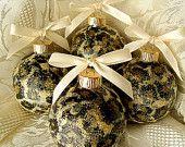 4 Cheetah Animal Print Round Glass Christmas Tree Ornaments With Cream Bows, Gold Glitter, So Chic. $20.00, via Etsy.