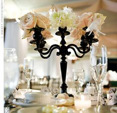 Small black candelabras with feathers, hydrangeas, and roses topped many of the tables. Candles and petals upped the romance.