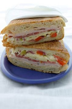 Who can resist a traditional hot Cuban sandwich with thinly sliced meats, pickles and melted cheese on perfectly pan-toasted bread? Our version is not quite traditional, but definitely delicious -- try piling on baby spinach, sliced red onion and roasted red peppers.