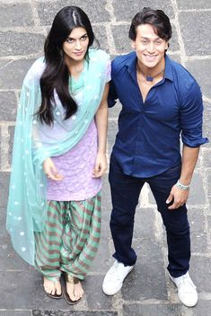 Tiger Shroff and Kriti Sanon outside Babulnath Temple. Custom made at Royal Threads Boutique.To order whatsapp@ Bollywood Couples, Bollywood Actress Hot Photos, Bollywood Girls, Bollywood Stars, Bollywood Fashion, Bollywood Pictures, Indian Celebrities, Bollywood Celebrities, Tiger Love