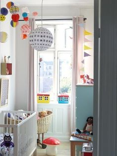 Another tiny space, but cleverly used. Lovely and airy, thank to the large window and the splashes of colour.