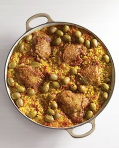 The traditional Spanish chicken and rice casserole gets its distinctive flavor from white wine, saffron, and pimiento-stuffed green olives. Nestle seared chicken thighs into the seasoned rice and cook everything together on the stovetop.