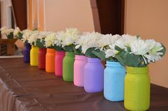 Daisy petal colored jars with Daisies in them to represent the lines of the Girl Scout law. Very cute and really pop off the brownie tablecloth