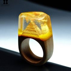 The Golden Pyramid wooden ring, inspired from the magnificent Egyptian pyramids ✨⚡ Only @sxwoodencreations wooden rings with artful landscapes and realistic environments!!! #sxwoodencreations #woodenrings #awsomering #handmadejewelry #handcrafted #rings #secretwood #miniature #world's #resinrings #Egypt #gold #pyramids #Pharaoh
