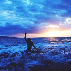 In the ocean sunset girl ocean clouds