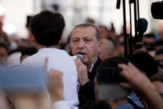 Turkish President Recep Tayyip Erdogan addresses the crowd following a funeral service for victims of the thwarted coup in Istanbul at…