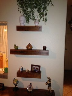 This listing is for three floating shelves one shelf is 24 long and two shelves are 16 long 31/2 tall and 5 deep made of pine. Shelves come with