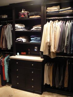Really nice walk-in closet system. Love the detail (like the molding) on the cabinets.