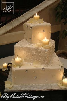 Cakes and Cupcakes wedding cake decorated with candles