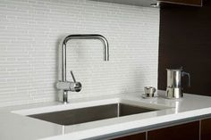 White Glass Tile Backsplash Gallery | white glas tiles backsplash contrast dark cabinetry provides the clean ...