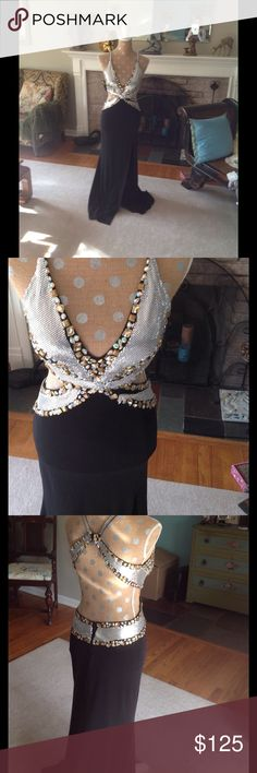 Chain mail Bedazzled Cutout Formal Go girl go! If you can get it on your body you should wear it silver metal mesh combined with gold and iridescent gemstones on a black stretch smooth fabric sides are cutout and back is low  three hook and eyes strap top of dress and zippers in back at skirt extreme side slit as seen in picture meant to be slightly long & sweep floor. Some stretch but you really need to be tiny . See pic silver mesh on front needs to be anchored prob a stitch or two. Priced…