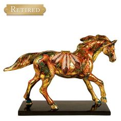 Golden Feather Painted Pony - Lynn Bean-You can review the complete line of Painted Ponies -watch some videos about them and learn their history off of: http://www.indianvillagemall.com/statue/ppmenu.html