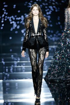 Zuhair Murad Couture Fall Winter 2015-16-Perforated black silk velvet tuxedo jacket, embellished with star-like crystals and worn with a fitted black Chantilly lace jumpsuit.