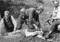 """Chetnik """"cutter"""" nicknamed """"Mosquito"""" sinks his knife into the throat of a communist partisan on Nov 13, 1943. """"Cutters"""" were tasked to kill enemy partisans only with knives. This photo helped identify the three Chetniks, who were later tracked down and killed by Tito's forces."""