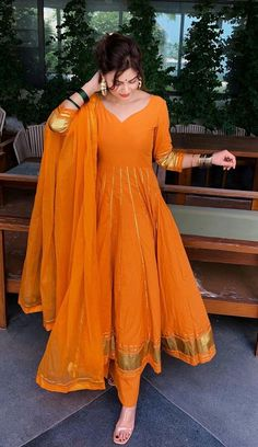 May 2020 - Orange cotton anarkali with hota detailing Pakistani Fashion Casual, Pakistani Dresses Casual, Indian Gowns Dresses, Pakistani Dress Design, Indian Fashion, Pakistani Mehndi Dress, Party Wear Dresses, Dress Outfits, Fashion Dresses