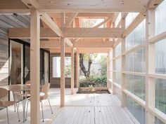 Japanese home reduces heating costs with greenhouse terrace