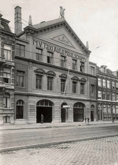 1950's. A view of the Plancius building at the Plantage Kerklaan in Amsterdam. The Plancius building dates from 1876. The initiative for the construction of the building came from the Jewish choral Oefening Baart Kunst. The property successively served as music temple and society, function room complex and, nearly 80 years, as a garage. Since 1999 it houses the Dutch resistance museum. #amsterdam #1950 #PlantageKerklaan #Plancius