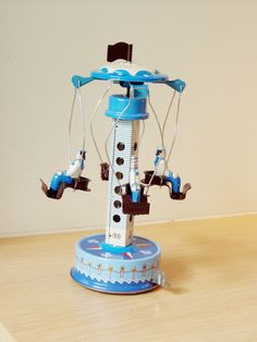 Vintage toys: Blue & white carnival ride with sailors, retro collectible toy. $ 19.35, via Etsy.